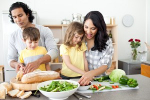Positive family preparing lunch together